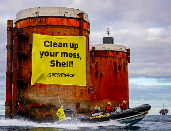 """Clean up your mess"", says Greenpeace flag on Shell's North Sea platform"